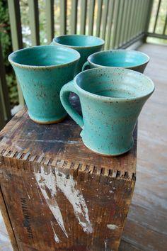 Blue pottery mugs