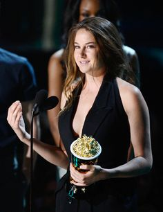 Shailene Woodley photographed on stage while accepting the Breakthrough Performance award for her role in 'The Descendants' at the 2012 MTV Movie Awards in Los Angeles.