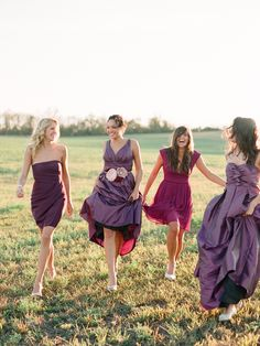 bridesmaids in lots of pretty purples