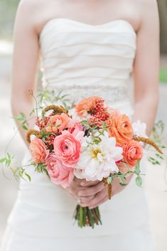 Coral + pink bridal bouquet #ranunculus  | Photography: Shannon Michele Photography - shannonmichelephotography.com/  Read More: http://www.stylemepretty.com/2014/04/23/pink-peach-backyard-charleston-wedding/