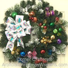 Christmas Presents Wreath - 2013 - Colorfully wrapped presents, ornaments, pinecones and decorations make our Christmas Presents Wreath a lovely eye catching wreath to highlight your Christmas decorating. - #ChristmasWreaths #Wreaths #ArtificialChristmasWreaths #Wreath