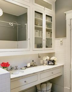 Glass knobs can add lots of charm in a bathroom.