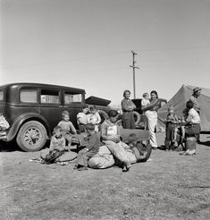 """March 1937. """"Four families, three of them related with 15 children, from the Dust Bowl in Texas in an overnight roadside camp near Calipatria, California."""" Photo by Dorothea Lange for the Resettlement Administration."""