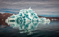 Iceberg eroded while melting. Photo taken in Scoresby Sund (Greenland) by Michael J. Quinn