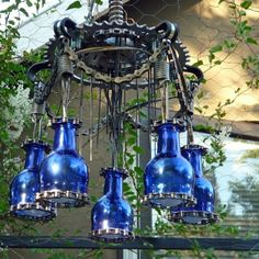 Chandelier made from bicycle parts and bottles