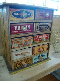 Cabinet made from coca-cola crates, cigar boxes & thread spools.