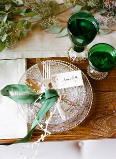 Emerald green perfectly accents the wood table and clear place setting