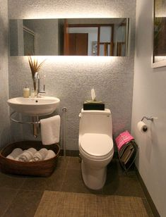 beautiful small bathroom Asian/minimalism grey texture walls, mirror with amazing lighting. floating pedestal-like basin with wrap around towel bar and towel storage basket