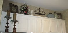 decorate tops of kitchen cabinets   How to Decorate the Space Above Your Kitchen Cabinetry