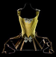 Articulated pannier and whalebone corset, circa 1740-60 Museum of Decorative Arts in The Louvre.