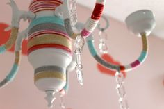 DIY Yarn-Wrapped Chandelier - what a fun and funky accent piece to this sweet nursery!