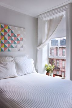i really want our bed by a window like this someday. love for watching the rain, or snow, or sunrise, or sunset.