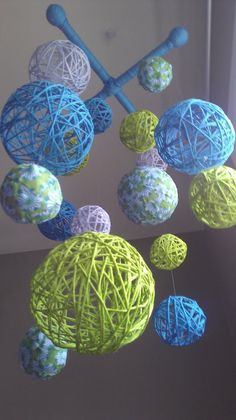 Baby mobile. This isn't a tutorial, but I've seen other websites that explain how to make yarn balls. Pretty cute!