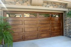 faux wood paint on metal garage door! Beautiful.  Would love to do this to our garage door.