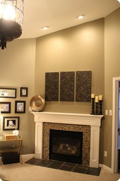 fireplace remodel, don't like the colors all that much but do like the general simplicity of  surrounding wood and the inner tile