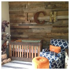 Nursery with wood pallet accent wall - this room has a rustic cabin feel that we just love!