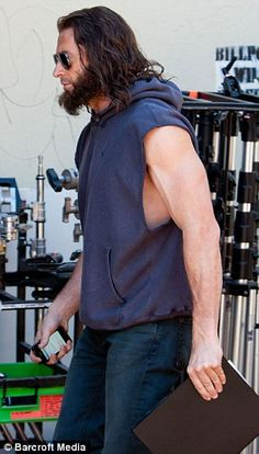 Don't make him angry! Hugh Jackman shows off his bulging biceps in a sleeveless hoodie on Wolverine set