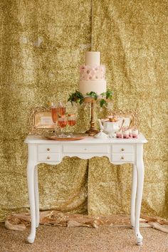 rose gold cake table // photo by Katelyn James // http://ruffledblog.com/rose-gold-wedding-ideas