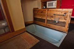 Small guest house built, the tub is in the living area and covered by a door when not in use.  by Louise Lakier