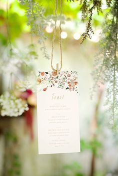 hanging menu idea http://www.weddingchicks.com/2013/10/15/brooklyn-garden-wedding/