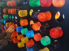Giant Window Lite Brite - made from wine rack type thing and water bottles filled with colored water