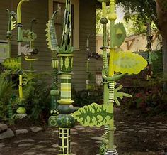 Ceramic totem poles in the backyard. (Okay, I want them too.)