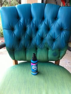 Spray-painting a chair with fabric paint.  Much better alt. to RIT dye.