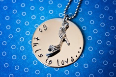 """So this is love..."" Cinderella inspired necklace, complete with high heel shoe charm.     Stamped on a stainless steel disc and hung on a stainless ball chain.     Can be personalized with a different quote from the movie, or something all your own!    Included in listing:  1 1/8"" stainless steel stamped disc  18"" stainless steel ball chain with 4"" extender and lobster clasp  High heel shoe charm    $20"