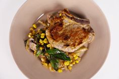 the chew | Recipe  | Michael Symon's Pork Chops With Basil Creamed Corn