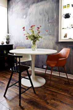 Mismatched chairs + tulip table + chalkboard wall