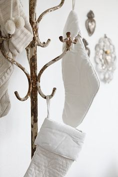Neat idea to hang stockings on a coat hanger- could use other things too