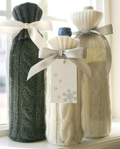 This doesn't lead to a pattern, but I found similar patterns here: http://www.michaels.com/Knit-Wine-Bottle-Cover/33548,default,pd.html. Another pin said these were sleeves from old sweaters.