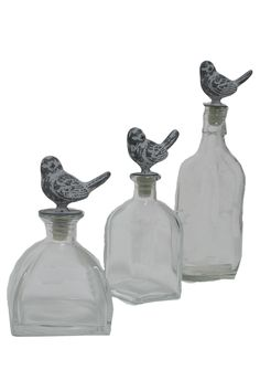 Bottles with bird toppers.