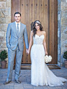 handsome groom in gray with stunning bride by his side captured by Joy Marie Photography http://www.weddingchicks.com/vendor-guide/joy-marie-photography/