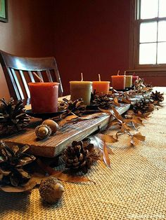 Fall decor.  I like the wood plank down the center.  I think my husband could cut a piece of wood down to the right size for my table, then we could stain it.  Might have to try this.
