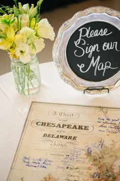 Cute guest book alternative: vintage map to have guests sign