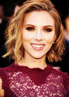 """Scarlett Johansson looks radiant with her messy """"lob"""" (long bob) hairstyle. This hairdo is fun and flirty, with choppy layers and loads of texture. It's also a low maintenance hairstyle, allowing your hair the freedom to take on its natural texture without additional products or heat styling."""