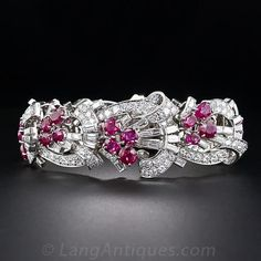 Art Deco Diamond and Ruby Bracelet. An opulent and exemplary original Art Deco bracelet from the 1930s. Each of the nine graduated platinum links radiates with a cluster of four extra-bright and richly saturated natural unheated Burmese rubies - totaling 20.00 carats. The rubies glisten and glow from within blazing cornucopias of baguette- and European-cut diamonds totaling 14.00 carats.