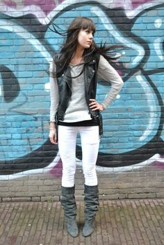 Still rock the look in winter with boots white pants an a black leather vest with a sweater underneath