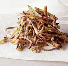 """I have to confess, french fries are one of my favorite foods. I can't resist them, whether they are from a fast-food drive-through or a fine restaurant. Luckily, these garlic-laced """"fries"""" satisfy my cravings in a more healthful way. They come out golden brown, tender on the inside and crisp ouside. A final toss with chopped parsley gives them that real French bistro feel."""