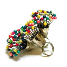 A pin bouquet ring for fashion designers and crafty ladies handcrafted by Theom Design.Adjustable ring.