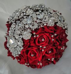 brouch bouquet, red bouquets, red and bling bouquets