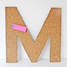 Turn a plain cork tile into a stylish and useful message or inspiration board.