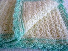 The stitch pattern on the main portion of this blanket is easy and creates a lovely texture. The shell edging adds decorative flair. This is a free crochet pattern from Modern Grace Design. crochet blankets, most popular, afghan, crocheted blankets, blanket patterns, crochet baby blankets, modern grace, crochet patterns, babi blanket