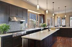 Espresso cabinets with light granite countertops - love!