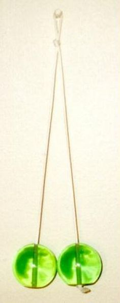 clackers! LOVED them!......Daddy hated these things but we loved them  Until they hit someone in the head.  dang were they hard
