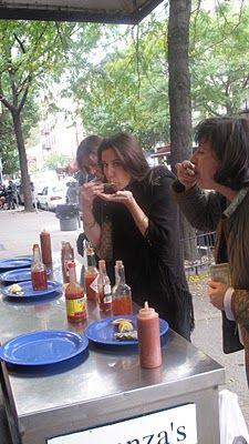 eating oysters on the go - arthur avenue