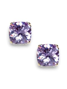 Oversized glass stud earrings in a feminine hue are the prettiest understated accent. Glass cushion cut stones in a rich lilac hue are set in a gold-tone base.