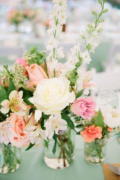 peachy floral arrangement, photo by Emily March Photography http://ruffledblog.com/tuckahoe-plantation-wedding #weddingflowers #flowers #centerpieces