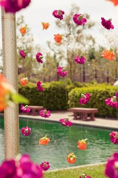 Diwali Party - flowers strung from fishing line; would be great behind the bar or from the chandelier above the buffet; all hot pink carnations